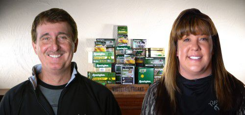 Don and Kandi in front of stacked Remington ammunition